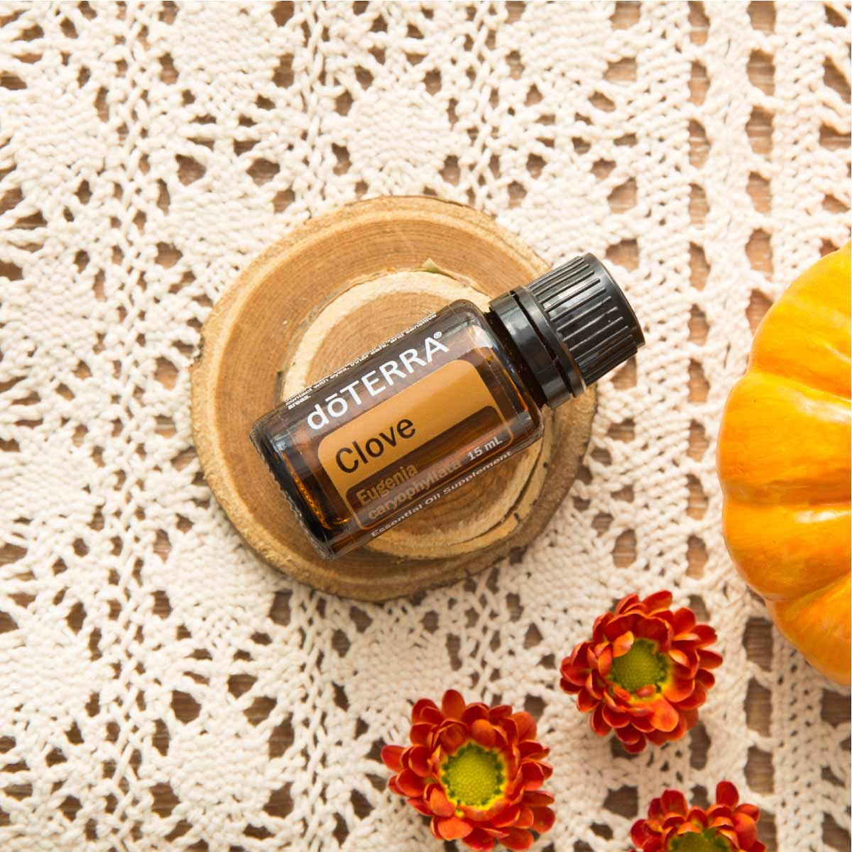 Bottle of doTERRA Clove essential oil. Wondering how to use Clove oil? Try using Clove oil as part of a warming massage, to add flavor to baked goods, or combine with water for a natural mouth rinse.