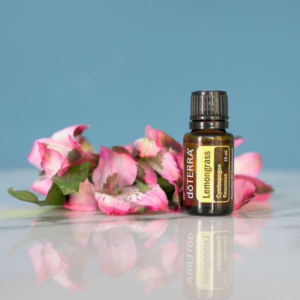 Pink flowers, bottle of doTERRA Lemongrass essential oil. What is lemongrass essential oil good for? Lemongrass oil is good for digestion, skin, massage, repelling bugs, and soothing anxious feelings.