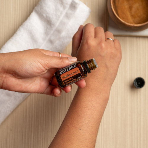 Woman applying Frankincense oil to her arm. Is it safe to use Frankincense oil on the skin? Yes, Frankincense essential oil can be used to improve the appearance of skin.