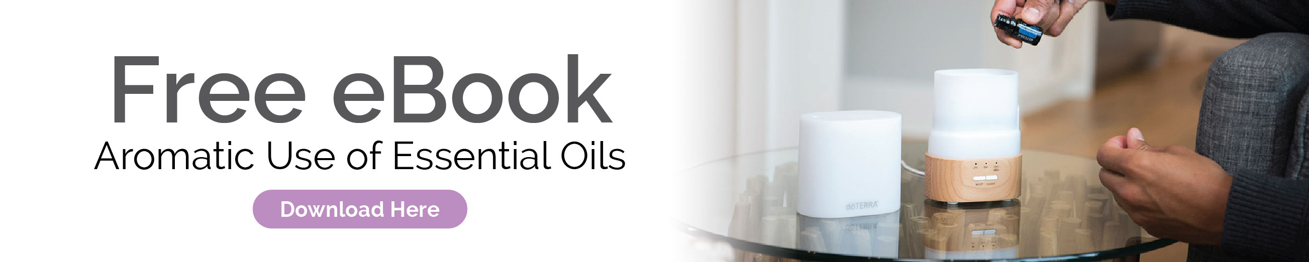 Person placing oil drops into essential oil diffuser. Get a free eBook, Aromatic Use of Essential Oils. Click here to download.