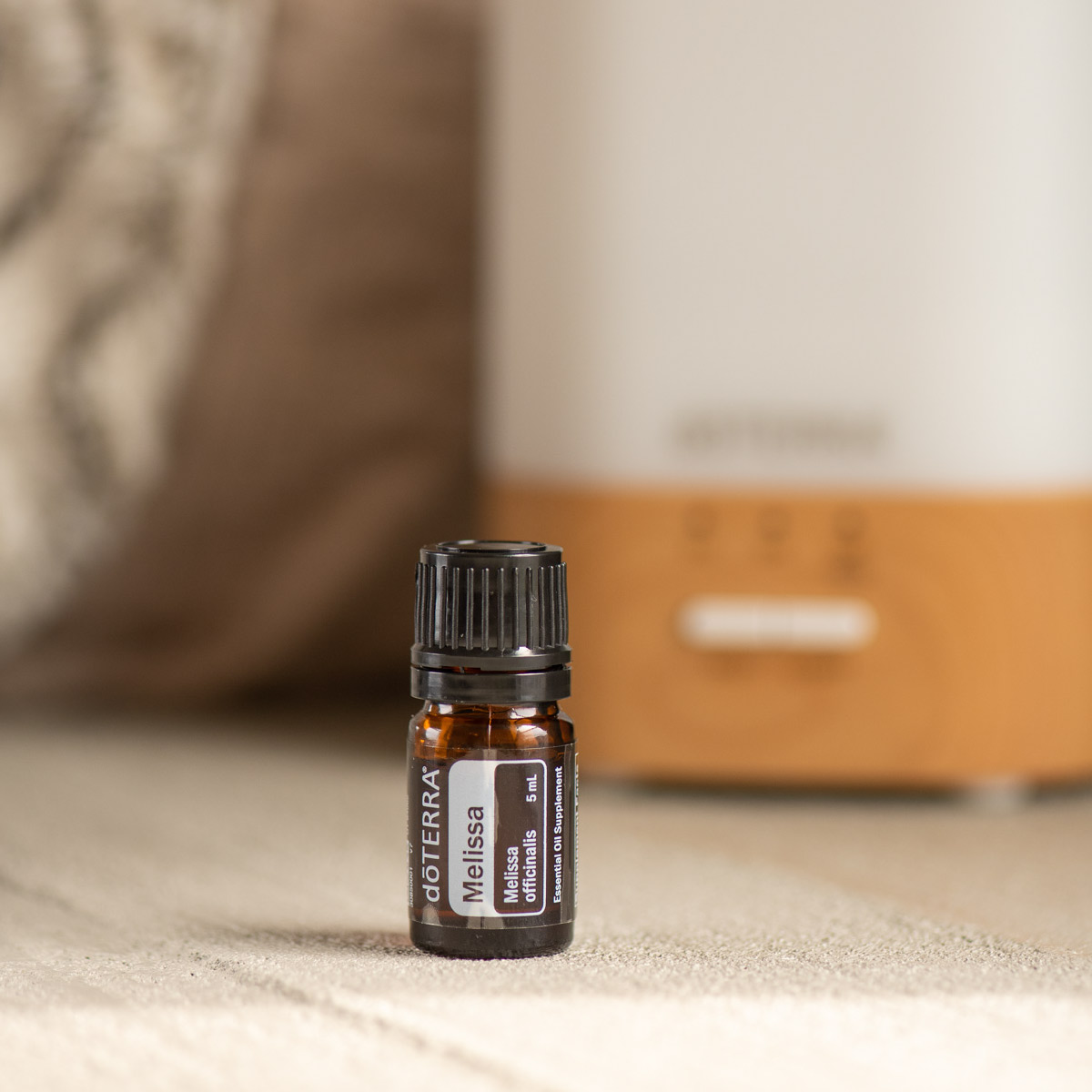 : Bottle of Melissa oil next to doTERRA diffuser. What does Melissa oil smell like? Melissa essential oil has a sweet, fresh, citrus-like fragrance.